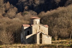 Religious object among nature or in the city. Christian religious building. Big Church, Christian cross. Ancient stone temple in the mountains.