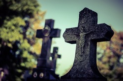 religious scary cross, symbol of cristianity in the graveyard