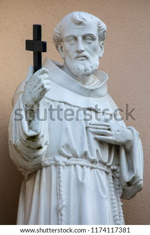 Religious Sculpture on the exterior of the Franciscan Friary Church in the historic city of Waterford, Republic of Ireland.