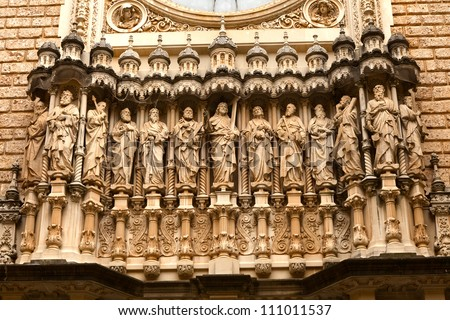 Religious sculptures on the facade of the basilica at the Benedictine Abbey at Montserrat, Santa Maria de Montserrat, near Barcelona, Catalonia, Spain, where some feel the Holy Grail had been