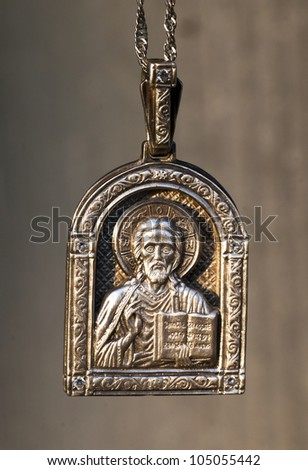 religious silver medallion of Nikolai ugodnik. (it is photographed at sunset).