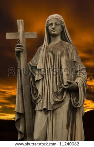 Religious statue at dusk.