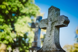 religious stone, symbol of cristianity in the graveyard