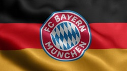 religious symbols of bayern munich. close up waving flag of bayern munich. bayern munich symbols on flag background.