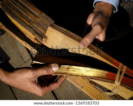 Religious texts on palm leaves in Nat Taung Kyaung monastery, Old Bagan, Burma #1369183703