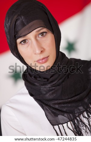 religious woman in kerchief over iraq flag