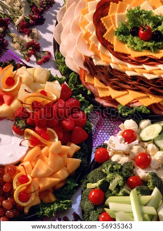 Relish, cheese, meat,  and fruit trays