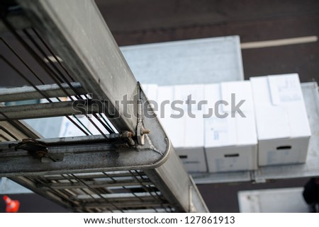 Relocation: Boxes on a lift being elevated from the moving van - stock photo