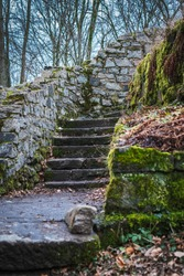 Remains of a staircase in a castle ruin in winter.
