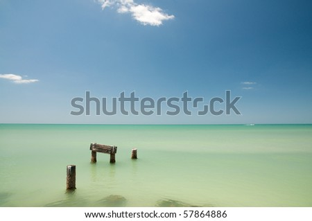 Remains of an old pier in the water right off the coast at Naples beach