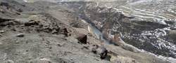 Remains of ancient bridge crossing river Arpa in medieval city Ani, near Kars, Turkey. Construction located on border between Armenia - Turkey. Ani all its buildings included in UNESCO Heritage List