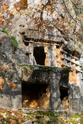 Remains of ancient Lycian rock necropol in Pinara ancient city in Turkey