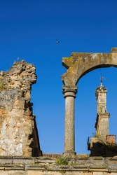 Remains of  Cistercian Monastery of Santa Maria de Sandoval. Ruined stone arch and church steeple