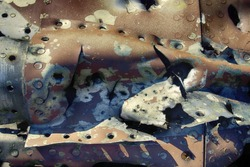 Remains of military aircraft (fighter) punched shell fragments and warmed by explosions of shells and bullets, splinter effect, fragment effect. Shoot down an aircraft, grand slam