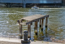 Remains of the Old wooden dock on Yarra river at one time used as a crossing bridge, Southbank on the beautiful sunny day.