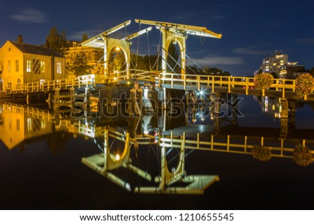 Rembrandt bridge and reflection in the river rijn in the city of Leiden at night, Holland, The Netherlands.