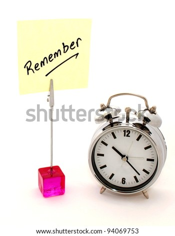Remember. Yellow note and alarm clock