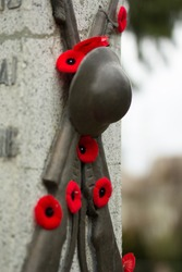 Remembrance day in Canada. Red poppies on monument.