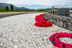 Remembrance day poppies laying close to the commando memorial in Spean bridge, Scotland - United Kingdom.