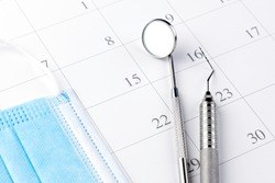 Reminder dentist appointment in calendar and professional dental tools.- Image