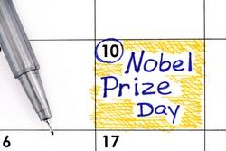 Reminder Nobel Prize Day in calendar with pen. December 10.