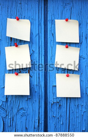 Reminder notes, blue wood background with space for your message