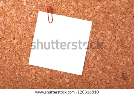 reminder notes with a paperclip on a noticeboard