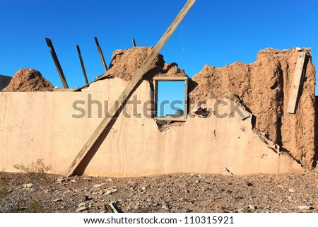 Remnant of Route 66/Collapsed adobe structure along historic US 66 - stock photo