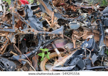 Remnants of the old motorbike piled together. #549291556