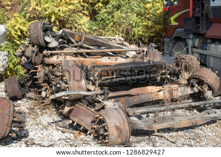 Remnants of vehicles in the dump. Vehicle disposal parts