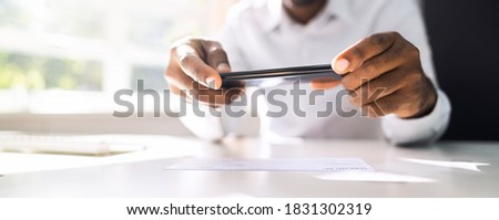 Remote Check Deposit Using Mobile Photo Scanning Photo stock ©