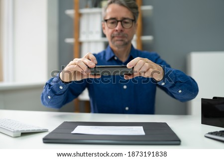 Remote Check Deposit Using Mobile Photo. Scanning Documents With Phone Photo stock ©