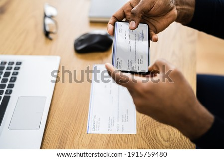 Remote Check Deposit Using Mobile Remote. Taking Photo Photo stock ©