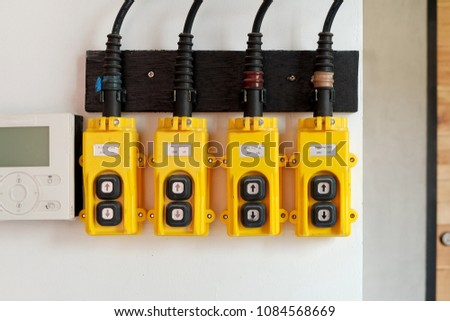 remote control air conditioner and Yellow remote control  for industrial hoist #1084568669