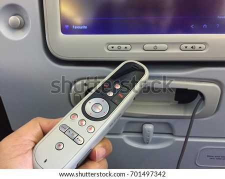 Remote control of airplane inflight entertainment. It makes travel on the plane more enjoyable.