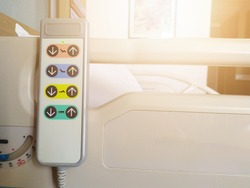 Remote control panel of electric adjustable bed in a hospital patient room use for adjust patient's bed for comfortable. Adjustable hospital bed. Remote with 8 button. Electric hospital bed