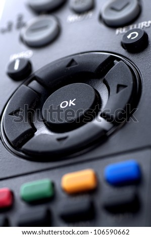 Remote control television shot with macro lens - stock photo