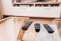 Remote controls on the coffee table - a place on the couch for relaxing and watching the media center - TV, DVD