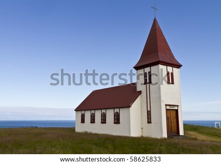 Remote Icelandic Lutheran church on the coast. Typical small simple structure of Icelandic churches