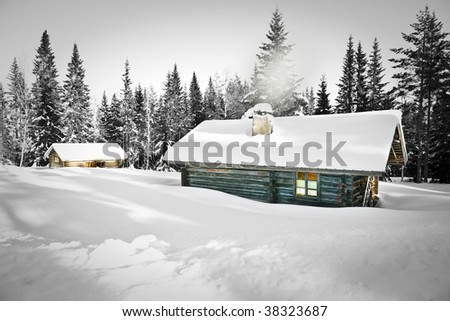 Remote log cabin in untouched snow - stock photo