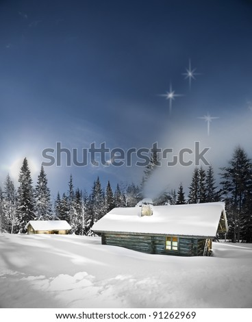 Remote log cabin in winter evening with stars in sky