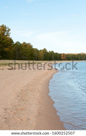 remote sandy shoreline with water