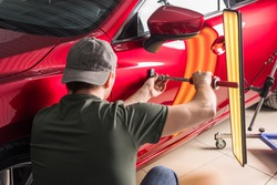 removal of dents without painting. PDR technology for car body repair