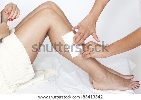 Removing hair from woman's legs