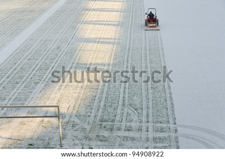 Removing snow from the pitch