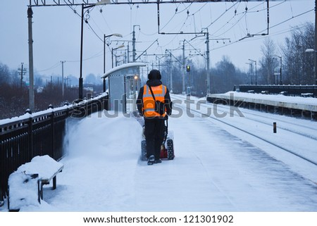 removing snow from the railway platform