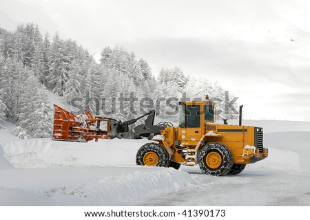 Removing snow from the road in winter
