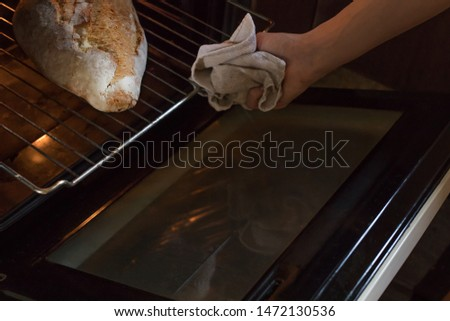 removing the artisan bread from the oven