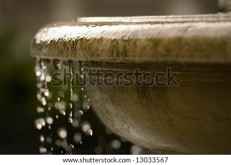 renaissance fountain closeup with waterdrops