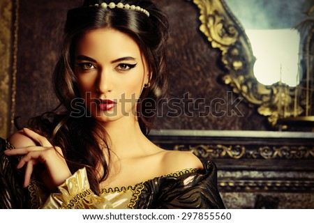 Renaissance Style -  beautiful young woman in the lush expensive dress in an old palace interior. Vintage style. Fashion. #297855560
